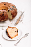 Slice of traditional German or Austrian Gugelhupf or Kouglof from Alsace, France, a round bundt cake with raisins made of brioche yeast sponge or sweet bread dough and dusted with sugar - 226876041