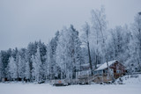House at the side of frozen lake. Finland - 226876276