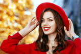 Outdoor close up portrait of young beautiful happy smiling girl with long hair, red lips, wearing stylish hat, looking up, posing, walking in street. Autumn fashion, lifestyle, advertising concept.