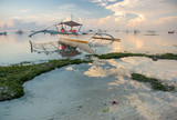 Boats on a tropical beach at sunrise - 226886619