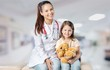 Young woman doctor with little girl
