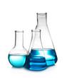 Leinwandbild Motiv Laboratory glassware with liquid on table against white background. Chemical analysis