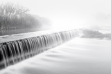 Mornig fog over a river dam