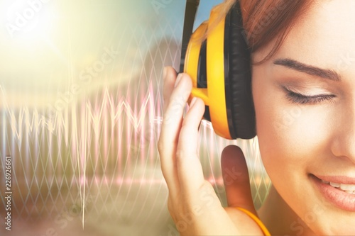 Leinwandbild Motiv Young relaxed woman listening, close up portrait