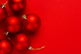 Christmas tree decoration balls on red background with copy space