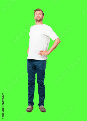 """Leinwanddruck Bild young blonde man with a proud, happy and confident expression; smiling and sure of success, pointing to one's self with both hands, giving an """"achiever"""" look."""