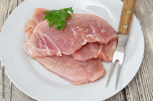 raw meat on a plate - 226959680