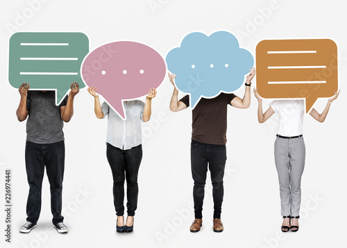Leinwandbild Motiv Diverse people holding speech bubble symbols
