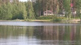 Romantic lake or pond in Finland with weekend house. - 226975287