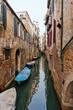 Narrow Venetian canal - Venice, Italy