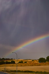 Rainbow over the fields in a stormy day  © Virginia