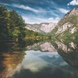 Lake Bohinj, landscape with lake and mountain on background. Amazing travel destination. Beautiful scenery. - 227004044