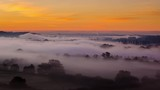 Time lapse of rolling mist at sunrise looking towards Reading from Whitchurch Hill, Berkshire, England, UK. - 227011626