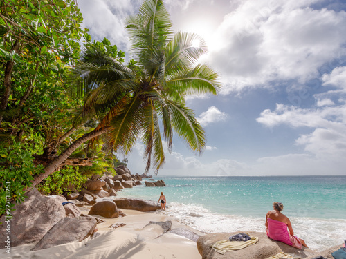 Fototapeten Strand Young woman enjoying the beach at Seychelles Praslin beach paradise holiday vacation. Travel to Seychelles for beautiful sea and white beaches in Indian Ocean, Africa. Rocks on the beach.