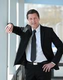 portrait of confident businessman on blurred background - 227013876