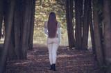 Pretty woman walking in the dark forest