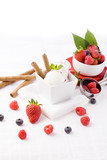 Ice cream on table decorated with berries
