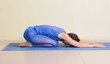 woman in child's pose yoga