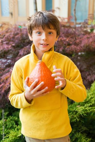 Foto Murales A boy in yellow shirt with pumpkin outdoor