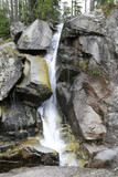 mountain waterfall among stones - 227034261