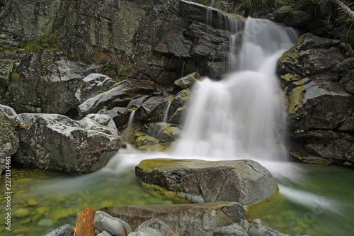 landscape with waterfall in mountains - 227034461