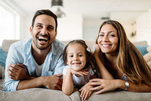 Happy family having fun time at home - 227039238