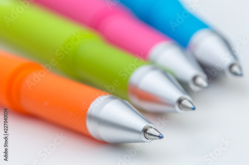 Leinwanddruck Bild Set of pens isolated on white background