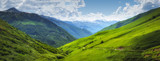 Vibrant mountain landscape. Green meadows on the high hills in Georgia, Svaneti region. Panoramic view on grassy highlands on sunny summer day. Caucasus mountains. Idyllic nature. Alpine valley - 227040216