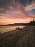 Horse ride along beach at sunset