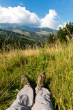 hikers boots on mountain meadow - 227053664