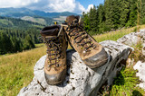hikers boots on stone in mountains - 227053683