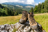 hikers boots on stone - 227053687