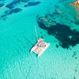 Drone aerial view of catamaran sailing boat in Maddalena Archipelago, Sardinia, Italy. Maddalena Archipelago is a group of islands between Corsica and north-eastern Sardinia. - 227054843