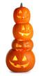 Leinwanddruck Bild - Stack of Halloween Pumpkins on white