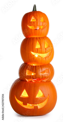 Leinwanddruck Bild Stack of Halloween Pumpkins on white