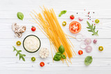 Ingredients for homemade pasta on wooden background. - 227066845
