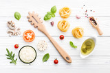 Ingredients for homemade pasta on wooden background. - 227066874