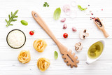 Ingredients for homemade pasta on wooden background. - 227066893