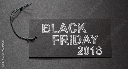 Black Friday 2018 text on a black tag on black paper background - 227071278