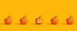 Leinwanddruck Bild - Halloween orange pumpkins on an orange background