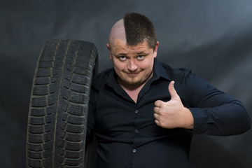Punk. Car tire near. A gesture of joy and contentment. © Вячеслав Козырев