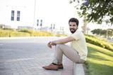 sitting on pavement - 227094865