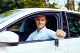 Smiling man sitting in his car and holding keys - 227098851