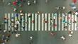 Aerial. Pedestrian motion on a crosswalk. Blurred.
