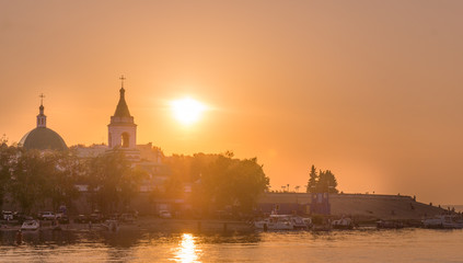Sunset, the sunset over the Orthodox church on the river Volga