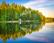 Leinwandbild Motiv Tampere Finland lake reflections on water with little house on the water, beautiful sky with many colors and trees