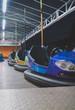 Quadro Electric bumper cars in amusement park.