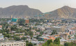 Kabul Afghanistan city scape skyline, mosque and Kabul hills mountains with houses and buildings - 227130622