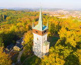 Aerial view to The Bolfanek viewtower with the St. Wolfgang´s cemetery chapel. Near a  marvelous village Chudenice from 12th century. Czech landmarks from above. Autumn in Central Europe. - 227131052