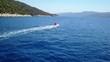 Drone footage of speedboat in Croatia between islands.